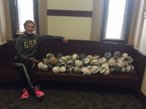 student with plarn balls