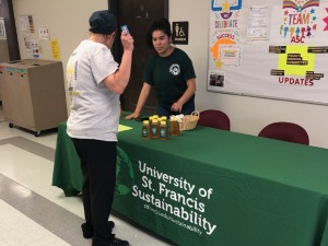 student selling honey