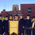 group of smiling 50th commencement alumni