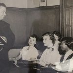 friar teaching a class of students