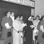 nun smiling with students