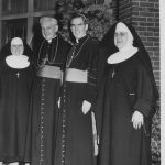 nuns with bishop smiling