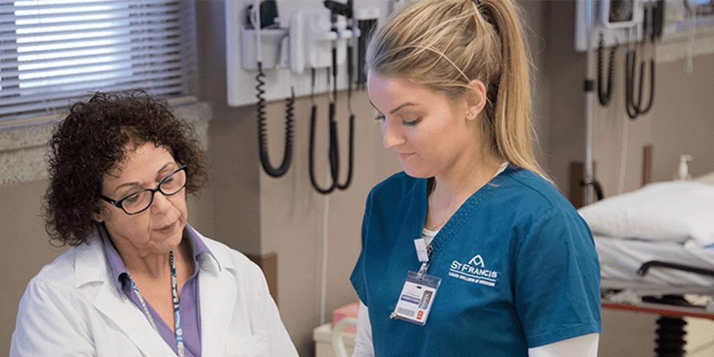 female nurse with usf faculty