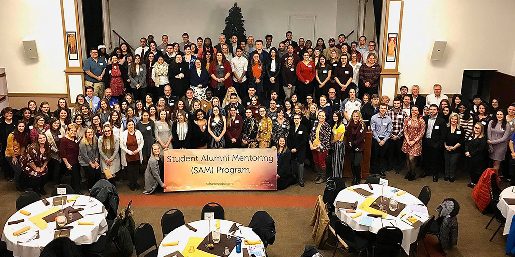 group of student and mentors