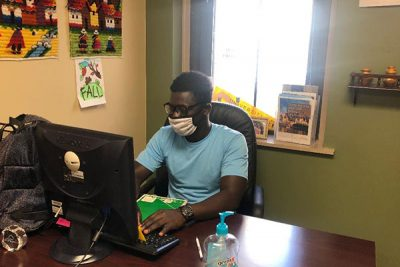 uss student felxi with mask working at a desk