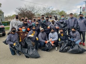 group of students picking up trash